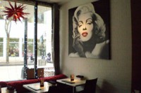 "The interior of ""The Icon,"" located at 206 State Street, is aptly decorated, with spotlighted artwork on the walls."