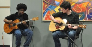 Two student musicians perform in the WolfPack Den as part of the Den's effort to add more entertainment.
