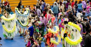 Spectators at Saturday's Pow Wow leave the stands to join dancers during an Intertribal song, during which everyone is invited to dance around the drum circles. Dancers would typically move clockwise around the different drum circles gathered in the center of the floor.