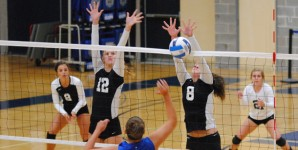 Madison College's Chrissy Marti (12) and Kensey Loger (8) go up for a block.