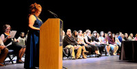 Candyce Hunter, shown, reflects during the induction ceremony on Feb. 13.