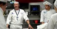 Madison College Culinary Program Director Mike Stark speaks to students in Truax's gourmet kitchen on April 2, 2013.