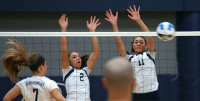 WolfPack Volleyball players block a shot