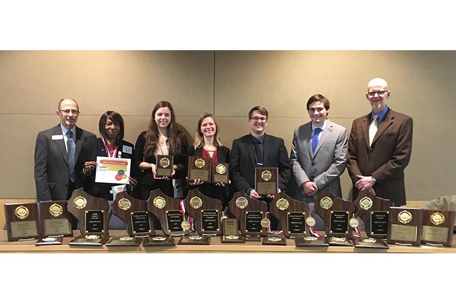 Members of the Madison College Business Professionals of America Club show the awards they won.
