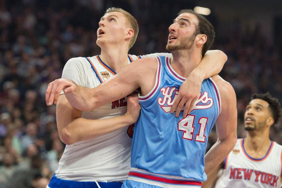 The New York Knicks' Kristaps Porzingis, left, defends the Sacramento Kings' Kosta Koufos (41) at Golden 1 Center in Sacramento, Calif., on Dec. 9. Porzingis' efforts during this year's NBA All-Star skills challenge was one of the few highlights from the league's all-star showcase.
