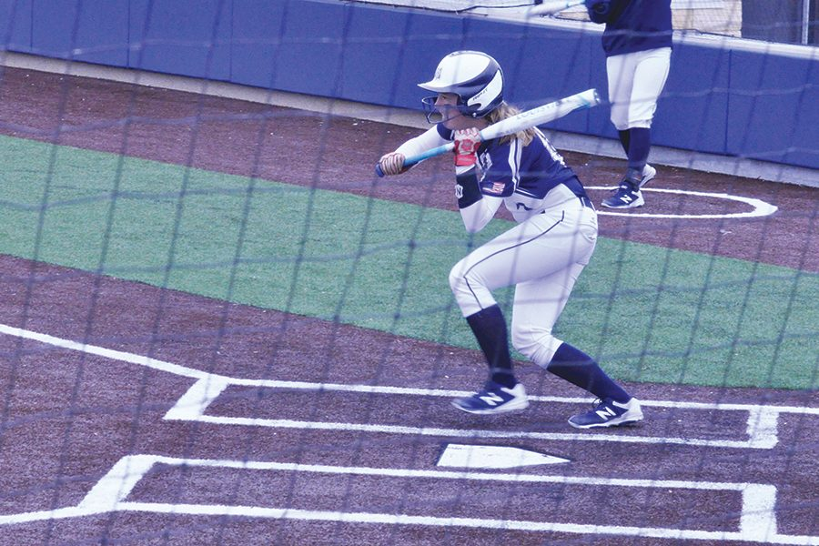Madison+College+softball+player+Brenna+Seeber+pulls+back+on+a+slap+hit+attempt+during+a+recent+game.