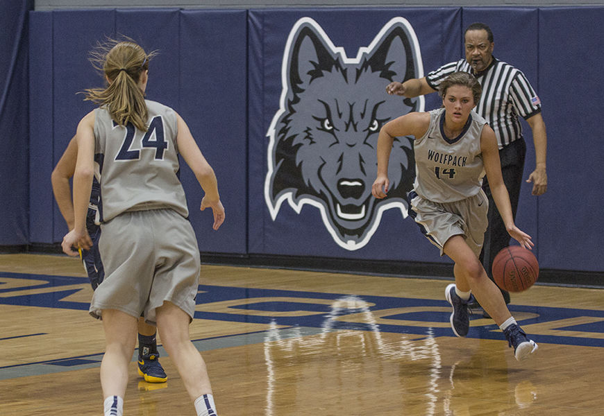 Madison College women's basketball player Rachel Slaney brings the ball up court.