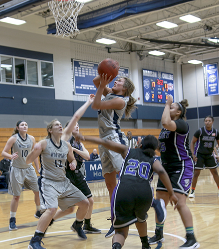 Madison College's Rachel Slaney battles to put up a shot during a game at home.