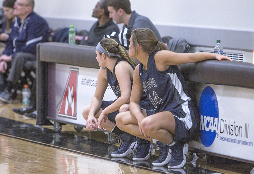 Rachel Slaney waits at the scorer's table to enter the game.