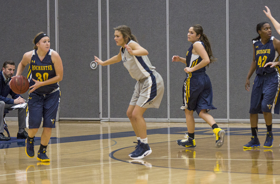Madison College women's basketball player Rachel Slaney plays defense against Rochester.