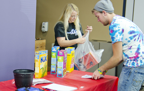 Student Ambassadors help with snack drive for child care center