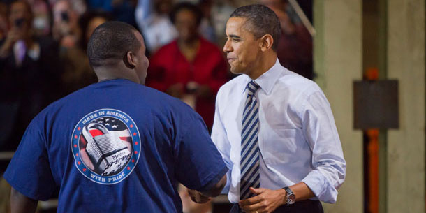 President Obama is welcomed to the Master Lock headquarters in Milwaukee