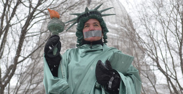 Protestor dressed as Lady Liberty on Capitol Square.