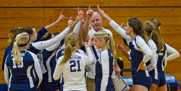 Coach Toby Parker gets the Madison College volleyball team ready for another match.