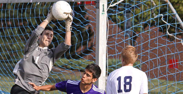 Madison College goalie Ian Murphy makes a save during his team's win over Harper College.