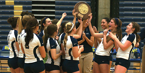 The+WolfPack+volleyball+team+celebrates+winning+the+NJCAA+Division+II+Regional+IV+Tournament+in+Rockford%2C+Ill.%2C+on+Nov.+2.