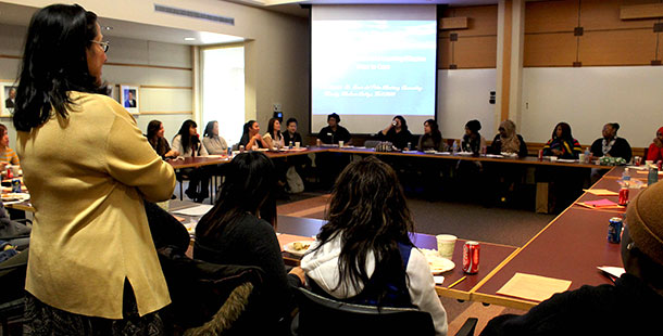 Madison College counselor Rocio Martinez leads a Women of Color Scholars meeting on Dec. 6.