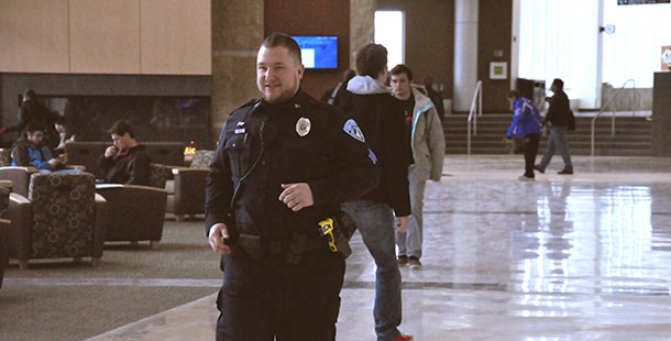Public Safety officer Joseph Steffan on his rounds of the Truax campus wearing a taser on his left hip.