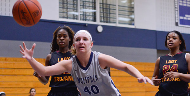 Madison College's Meagan Mazur (40) tries to save a ball from going out of bounds against Triton College on Jan. 8.