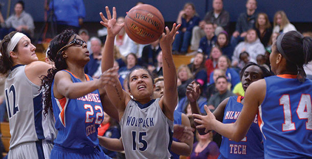 Madison College's Gabrielle Hood (15) grabs a rebound on Feb. 8 against Milwaukee Technical College.
