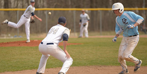 Madison College first baseman Mike Jordahl waits for a pick-off throw from pitcher Nate Hoffmann during a recent game at home.