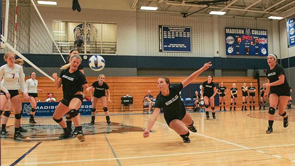 The Madison College volleyball team participates in a pre-season scrimmage.