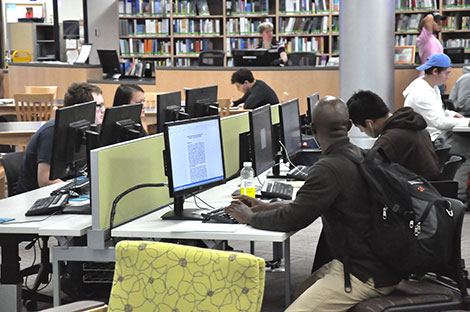 Students work on research for their class projects in the Truax campus library.