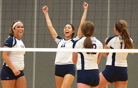 The Madison College volleyball team celebrates a win over Edgewood JV on Oct. 23.