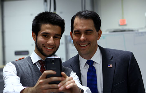 Student Senator A.J. Cifuentes takes a selfie with Gov. Walker
