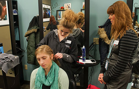 Amy Johnson gets her hair braided at the Trustyle Salon.
