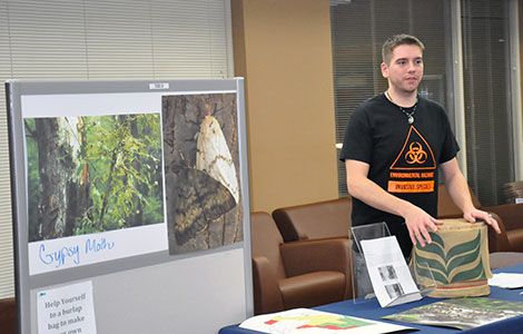 Phi Theta Kappa members presented their honors project on invasive species in the Truax Student Lounge.
