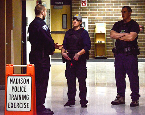 Officers visit outside the WolfPack Den during a training exercise held at the Madison College Truax Campus on Jan. 12