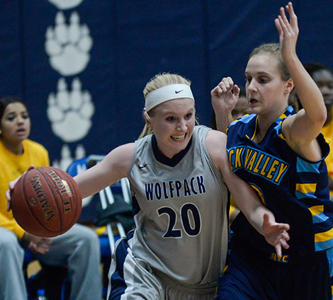 Madison College's Taylor Nelson (20) drives past a Rock Valley College defender during her team's 87-79 loss on Jan. 14.