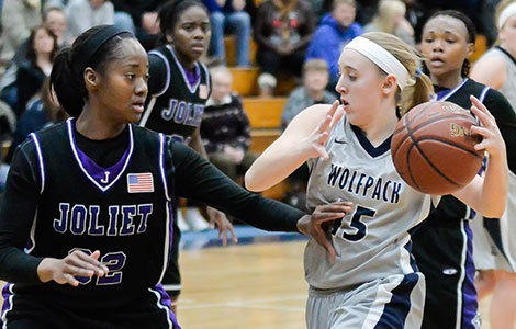 Madison College's Kaitlyn Kast, right, drives past a Joliet defender during a win at home on Jan. 28.