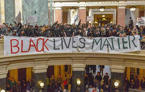 """Students protesting at the State Capitol rotunda in Madison earlier this month hold a banner proclaiming, """"Black Lives Matter."""""""