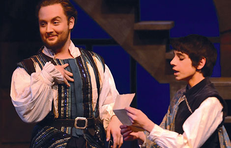 Benvolio and Romeo discuss evening plans. Fine acting, along with an equisite set and intricate costuming, brought Romeo and Juiiet to a profession level production.