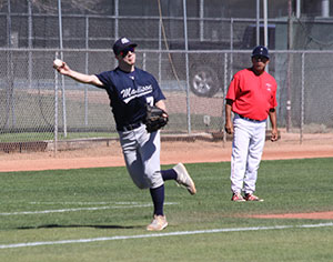 Madison College's Brandon Gibis makes a throw from third base during one of the team's games during the spring break trip.