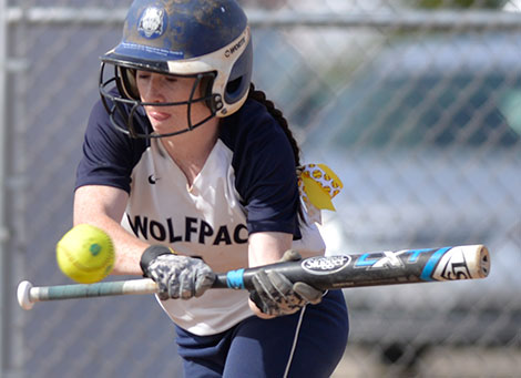 Madison College outfielder Sadie Holmes bunts the ball during a recent home game. The WolfPack softball team has won 7 of its last 10 games and has assured itself a winning record for the season with a 29-15 overall record.