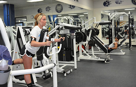 Students work out in the Madison College Fitness Center on the Truax campus on May 4. The center will be closed through August as it undergoes a second phase of renovations to make the space more safe, user-friendly and efficient.