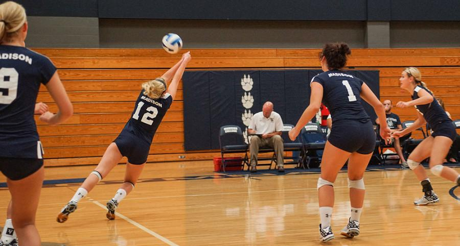 Miranda Durbin (12) dives for the ball during the Sept. 3 volleyball match against Milwaukee Tech.