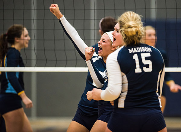 Madison College volleyball players celebrate another point against Rock Valley College on Sept. 22.