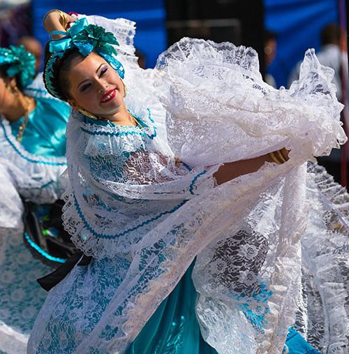 Cathryn Mellender of Ballet Folklorico Zihua performs a traditional Mexican dance in costumes made by Ballet Folklorico Zihua Director Dulce Mellender.