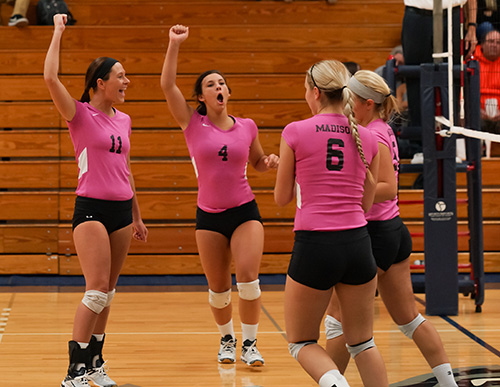 Madison College's volleyball team celebrates during a recent match.