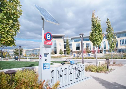 The BCycle station is located outside the Health Education and Information Thechnology Building, across the street from the Truax Gateway.