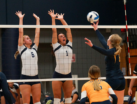 Madison College's Taylor Genthe (6) and Andrea Bauer (1) go up for a block against Lakeland College JV on Oct. 8