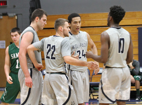 Members of the Madison College men's basketball team talk during a break in play during the Border Battle Tournament held at Madison College on Nov. 6-7.