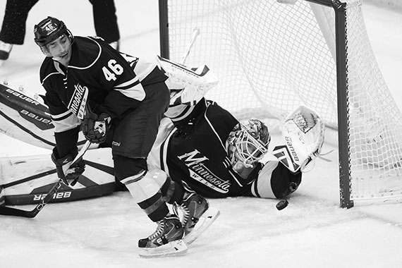 Minnesota Wild goalie Devan Dubnyk (40) stops a shot by the Chicago Blackhawks in the first period on Oct. 30 at the Xcel Energy Center in St. Paul, Minn.