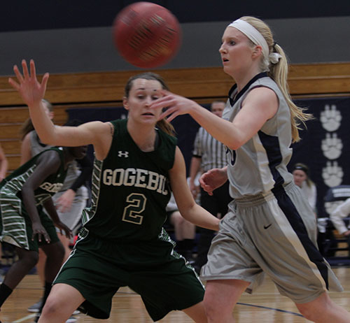 Madison College's Taylor Nelson, right, passes around a Gogebic opponent during a game at home on Saturday, Nov. 2. The WolfPack women's basketball team posted a 68-50 victory, improving its record to 3-0.