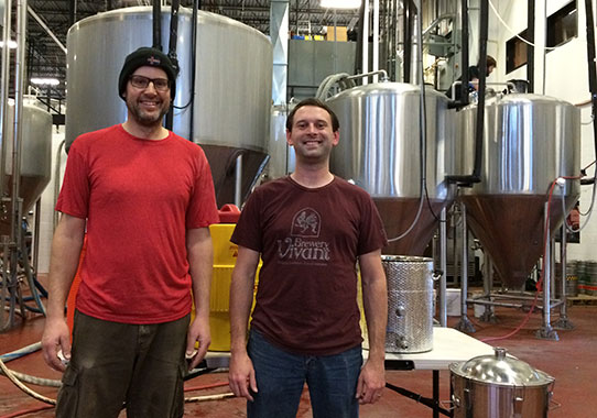 John Schuppel, left, completed the Craft Brewing Certificate Program at Madison College and now works for Ale Asylum along with Joe Waltz, right, the quality control manager at the brewery.