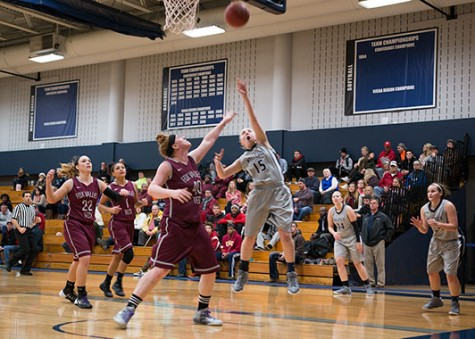 Kaitlyn Kast (15) leaps for the ball during WolfPack 96-37 win against the Fox Valley Technical College Foxes on Jan. 4.